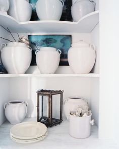 Details Photo - Shelves of creamware in a white kitchen