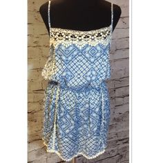 % RAYON GORGEOUS ROMPER WITH LACE DETAIL This romper is so pretty and girly with beautiful detail and adjustable straps. JUNIOR SIZING Shorts