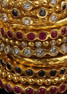 Stackable 22k gold rings set with black & white diamonds, rubies by Osnat Weingarten