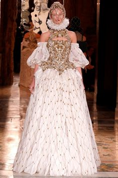 Alexander McQueen Romantic Period lowered arm opening and a puffed sleeve