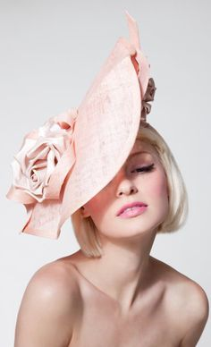 Dillon Wallwork - Peach sculpted sinamay disc trimmed with silk satin rosebuds.