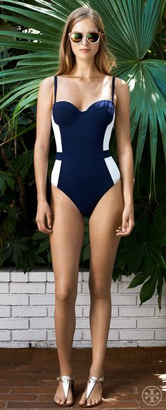 I'm not one for one piece suits but this is cute! A classic palette, an ultra-flattering silhouette | Tory Burch Resort 2014