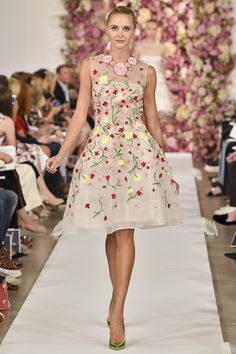 """Spring was in the air chez Oscar de la Renta, as Beethoven's """"Pastorale"""" symphony trilled its jocund promise and the designer's cabine of models stepped out like high-strutting thoroughbreds through a doorway embowered in dusty pink carnations and hydrangea."""