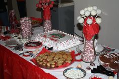Ohio State themed cake and candy table with buckeyes, red and white mints, football cookies, twizzlers, yogurt covered raisins, red and white cake pops and swedish fish. Fill a bag as favors.