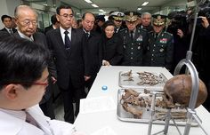 South Korean Defence Minister Lee Sang-hee tours a laboratory inside the National Cemetery in Seoul. The facility is dedicated to exhuming and identifying the remains of soldiers killed during the 1950-53 Korean War