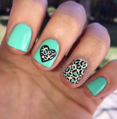Cute blue inspired leopard nail art design.