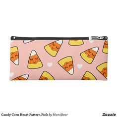 Candy Corn Heart Pattern Pink Pencil Case by NamiBear on Zazzle.com. This is a drawing of a candy corn with a smile on her face with hearts around her. It has a pink background.