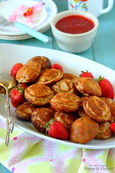 PEANUT BUTTER STUFFED BANANA EBELSKIVERS. Ebelskivers or Æbleskivers are little pancake puffs cooked in a special ebelskiver pan. This version is made with whole wheat flour and bananas and stuffed with peanut butter for a creamy center. Served with strawberry sauce, this makes for a delightful breakfast or quick snack. #happyandharried #banana #ebelskivers #pancake #peanut #butter #snack #brunch #breakfast #recipe