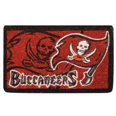 "Tampa Bay Buccaneers Welcome Mat by Team Sports America. $34.99. Made of 100% coconut coir. Our large 18"" x 30"" team logo welcome mats have been uniquely crafted by skilled Indian artisans using centuries of old traditional methods. Each mat features your favorite team's logo and a unique design that is featured in full color. Enviromentally safe product. These licensed team logo mats are wholly natural products and are fully bio-degradable. NFL Tampa Bay Buccaneers Welcome Mat"