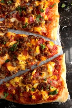 Everything you love about breakfast on a Breakfast Pizza! This Breakfast Pizza had scrambled Eggs, Sausage, Bacon & cheese! Great with a dash of hot sauce!
