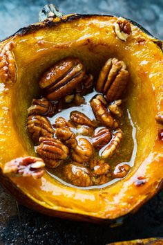 Maple Pecan Roasted Acorn Squash - Easy roasted acorn squash boats filled with buttery maple syrup and topped with crunchy toasted pecans! Veggie Recipes, Fall Recipes, Holiday Recipes, Vegetarian Recipes, Cooking Recipes, Thanksgiving Recipes, Cooking Beef, Oven Cooking, Cooking Food