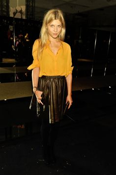 Leather skirt, yellow shirt. Love Clemence Poesy.
