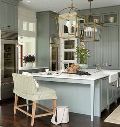 """Cabinet and kitchen island paint color is """"Sherwin Williams SW 6207 Retreat"""".   Urban Grace Interiors."""