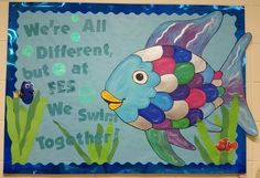 Rainbow Fish Bulletin Board for our Library featuring Dory and Nemo - New Deko Sites Rainbow Fish Bulletin Board, Fish Bulletin Boards, Diversity Bulletin Board, Kindergarten Bulletin Boards, Summer Bulletin Boards, Back To School Bulletin Boards, Classroom Bulletin Boards, Classroom Themes, Classroom Door