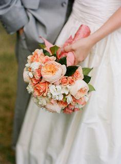 Illsa spray roses, peach juliet cabbage roses, white hydrangea, white stock, and white freesia.