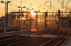 Red signs - A row of red signs over the railroad tracks at Perrache station in Lyon, France, during a spring sunrise.