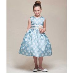 A gorgeous flower girl or Easter dress for your little girl from Crayon Kids.  This tea length dress has a cute polka dot print.  The layered sash at the waist is adorned with an attached flower and ties in the back.  Attached crinoline underskirt adds fu