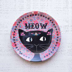 """Cat """"Meow"""" Mini Melamine Plate - We LOVE our Mini Melamine Plates! Perfect for gifting small treats to friends on fun occasions, birthdays or for no reason at all! """"Meow"""" saying and black cat over a pink floral background."""
