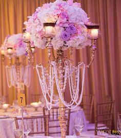 So far this is my number one pick for center pieces. (Tall lavender wedding centerpiece with hanging  pearls idea)