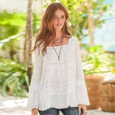 EVERYTHING TO LOVE TUNIC - This tunic delights with eyelet lace detail, square neck, ruffled hem and tonal embroidery.