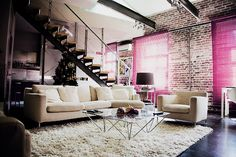 Love the pink blinds and brick walls :)