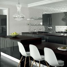 High gloss kitchen Doors are visually stunning, hard-wearing and epitomise a modern home. With lighter colours in particular, gloss reflects natural light and creates a sense of space. Combine this with a simple slab or handleless door and the effect is accentuated. Make a design statement with Zurfiz in Ultragloss Metallic Anthracite. The light bounces off these ultragloss surfaces, creating an elegant and bold space. Coupled with statement tiles and white chairs for contemporary… High Gloss Kitchen Cabinets, Kitchen Cabinet Doors, Cheap Kitchen, Diy Kitchen, Anthracite Kitchen, Kitchen Furniture, Dining Table, White Chairs, Contemporary