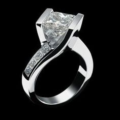 Princess Cut Diamond Engagement Rings. A little tall for me but I love the boldness!