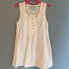 "Anthropologie Lace Trim Tunic so pretty and easy breezy for Spring/ Summer. lightweight gauzy cream colored cotton tunic with pretty antique looking lace detailing. Features four button placket and pin tucking on bodice and pockets. 109% cotton. bust is 17.5"", length is 30.5"". excellent condition. size 2. Anthropologie Tops Tunics"