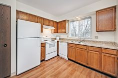 Kitchen with oak cabinets and new wood floors