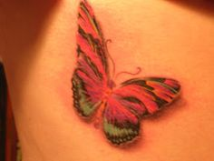 "Thyroid Cancer Survivor tattoo ""The colors of the tattoo needed to be the colors of the thyroid cancer survivor ribbon: pink, turquoise and purple. They stand for mind, body and spirit..."""
