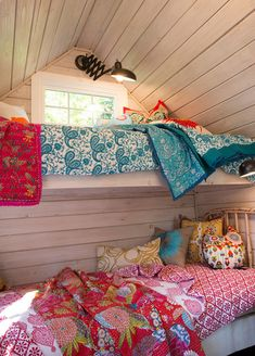 Modern quilts are such a child-friendly way to decorate kids' beds. They are warm, ensconcing, colorful and snuggle inducing, and they come in an almost infinite range of colors.