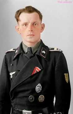 Colorised by myself, a NCO (Non commissioned officer) from the Panzertruppen wearing a Silver assault badge (Panzerkampfabzeichen), badge wound badge (Verwundetenabzeichen) DRL Sport badge in bronze (Deutscher Reichsbund fur Leibesubungen), Krim shield (Ärmelschild Krim), Ost front ribbon (Ostmedaille) and EK2 ribbon (Eisernen Kreuz Klasse 2)