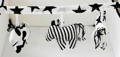 Horse rattles hanging on a fabric chain.   The stylish 3-horses rattles chain to hang over baby's cot or on the wall , all hand made ,100% cotton ,in black & white fabric colors.  Price: $49