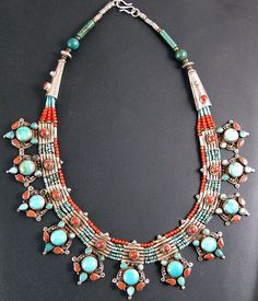 Turquoise & coral fine necklace. Finely worked Necklace made from silver with coral and turquoise.   Handcrafted in Nepal using traditional Tibetan designs.:
