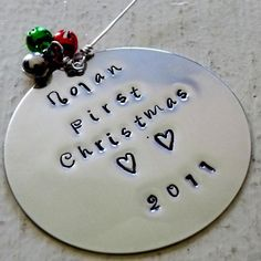 Personalized Christmas Baby's First Christmas Silver Ornament Jingle Bell Handstamped FREE SHIP. $25.00, via Etsy.