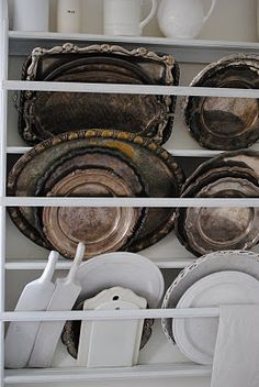 Silver Trays & White Dishes paint plate rack from attic and use like yhis?