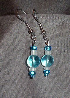 Aqua Blue Glass Ball Earring - Aqua blue glass ball earring surrounded by smaller aqua beads and white beads.