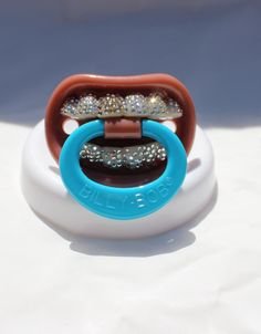 Funny Teeth Blinged Out Baby Pacifier w/Swarovski Crystals. $35.00, via Etsy.