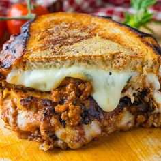 A grilled cheese sandwich stuffed with a tasty bolognese sauce, fresh basil and three kinds of melted cheese with extra parmesan cheese toasted onto the outside of the bread until golden brown and crisp! Cooking For A Group, New Cooking, Sandwiches, Hamburger, New Recipes, Cooking Recipes, Recipies, Grilled Cheese Recipes, Cheese Toast