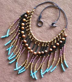 Native American style tribal fringed collar necklace in turquoise and gold pearl