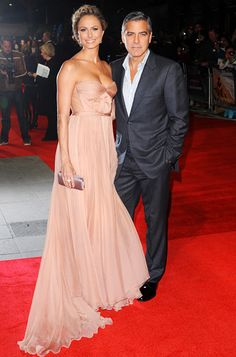"""Stacy Keibler  For the London debut of The Descendants, Stacy Keibler slipped on a blush chiffon Maria Lucia Hohan gown—the same design that Vanessa Hudgens wore in yellow. """"I thought wow, what a beautiful healthy glowing girl and how amazing the dress looked on her!"""" Hohan said of seeing Keibler in the look."""