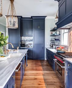 Blue kitchens are everywhere! What are your thoughts on this hot, new trend? | photo by @chrisveithinteriors |