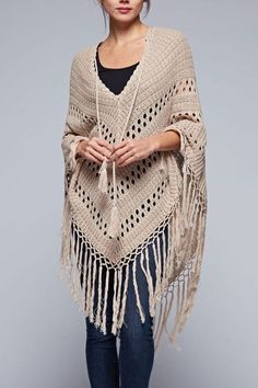 Inspiration...This bohemian inspired crochet poncho has a long tassel tie in front and long fringed hemline. Ultra soft cotton/acrylic blend yarn in a soft, neutral tone to