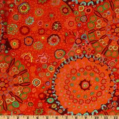 Kaffe Fassett.  (sp?) Although I'm generally not fond of red, this color combination is delicious.  It would set off the differing chair colors nicely and not clash, but beautifully contrast.