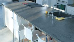 Poured Concrete Countertops With Modern Chairs