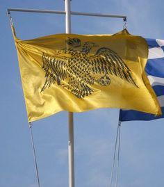 The flag of the Greek Orthodox Church, alongside modern Greece's flag