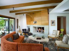 Teak wood squares applied in a basket-weave pattern add intrigue to this fireplace design by Lori Dennis and SoCalContractor. Not ready for a structural do-over? Bring your gas fireplace up to date by subbing in concrete rock balls for the tried-and-true faux logs. Voila! Instant update.