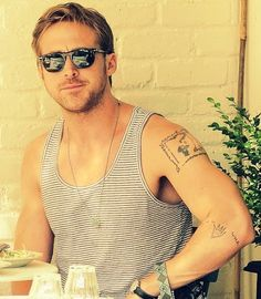 Ryan Gosling has the cover of 'The Giving Tree' tattooed on his arm. Yes, I love him more for this.
