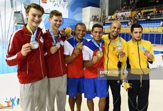 July 13 - Diving - Men's Synchronised 10m Platform.  Silver medal winners Philippe Gagne (L) and Vincent Riendeau (2L) of Canada, Jeinkier Aguirre(3R) and Jose Antonio Guerra (3L) of Cuba and Victor Ortega (2R) and Juan Guillermo Rios of Colombia pose for a photo after the Men's Synchronised 10m Platform Finals during the 2015 Pan American Games in Toronto, Canada on July 13, 2015. AFP PHOTO / TIMOTHY A. CLARY