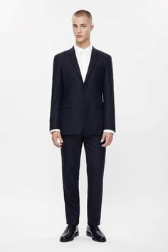 Made from lightly textured wool, this two-button blazer is classic style with a narrow notched lapel. Fully lined, it is a regular fit and has a welt chest pocket, simple back vent and front flap pockets. Wear with our textured wool trousers for a classic formal look.